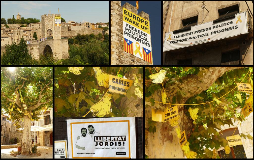 De protestboodschap domineert het iconische stadsgezicht van Besalú. Toeristen kunnen het ook lezen op het spandoek aan de gevel van het gemeentehuis. Op het centrale plein van de stad, dat toepasselijk genoeg het plein van de vrijheid heet, draagt een grote plataan linten en kaarten met namen van de politieke gevangenen en ballingen. Alle foto's ©2018 Huib J. Lirb